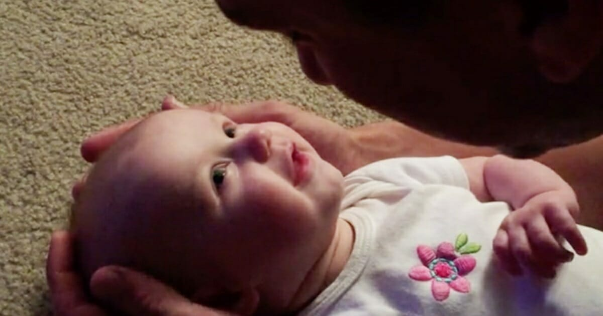 Dad sings classic song to baby daughter - the clip of her